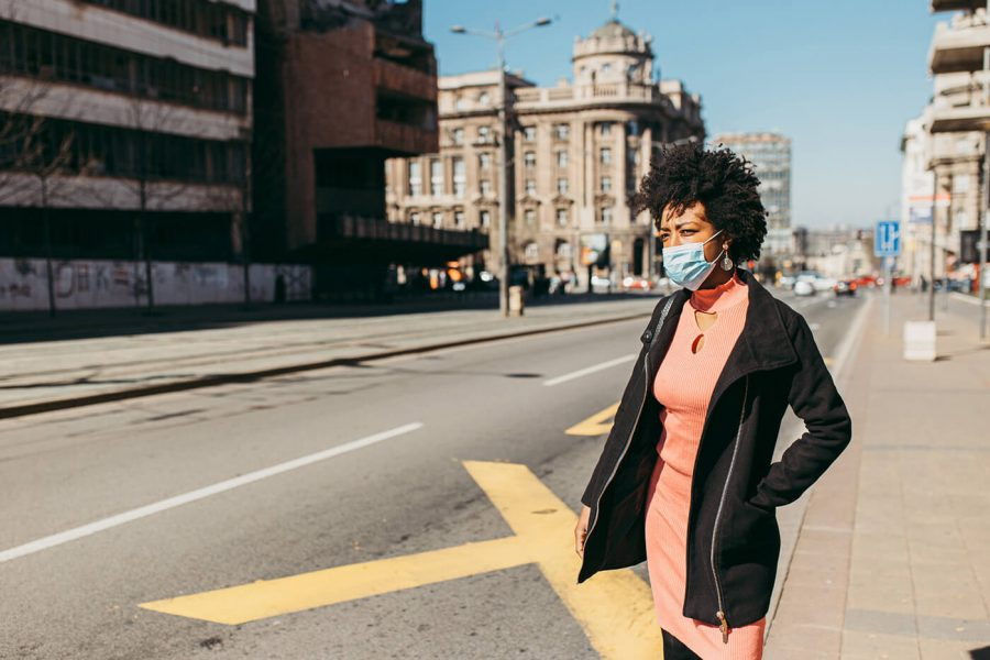 Portrait Of Young Woman With Mask On The Street