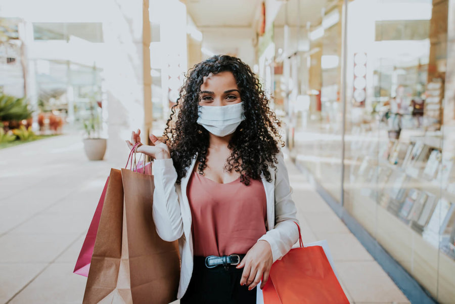 Woman walking shopping and Smiling behind the mask COVID
