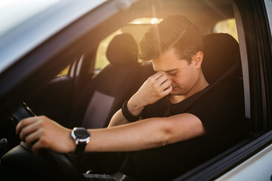 Having a headache while driving car