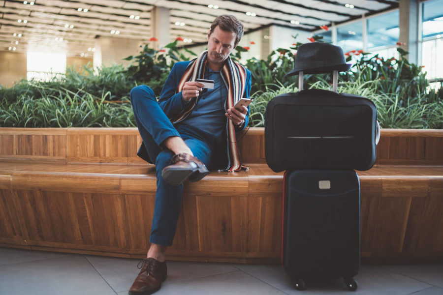 Businessman using online banking at the airport