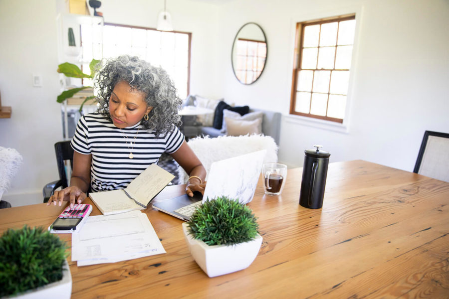 Mature Black Woman Working at Home on laptop