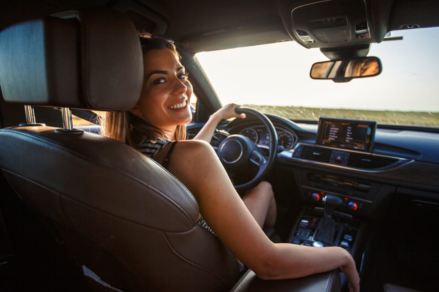 Smiling young woman going on a road trip