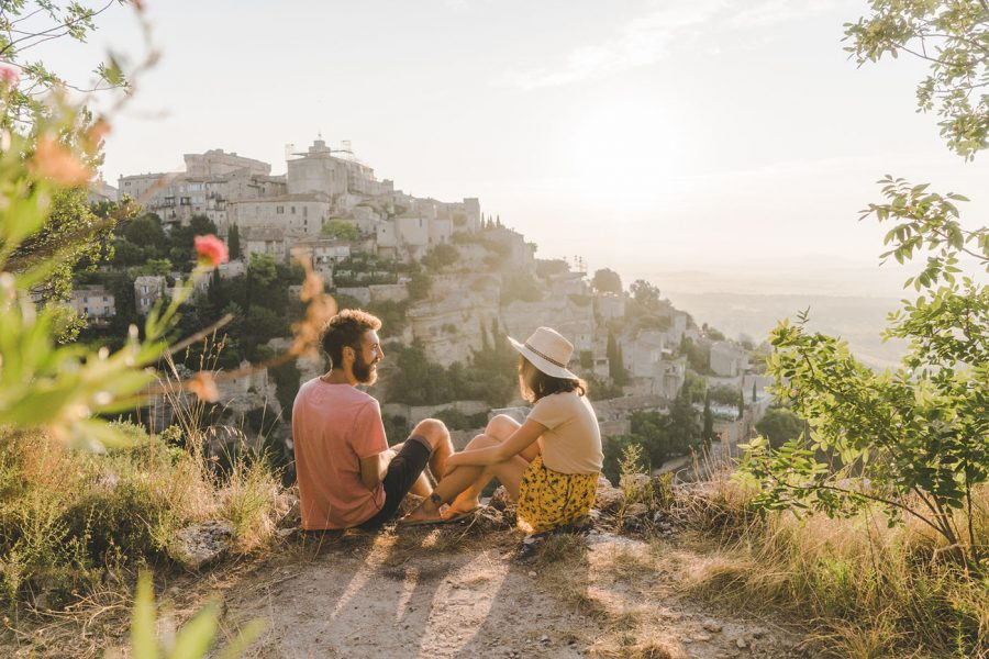 Young Caucasian woman and man looking at scenic view of Gordes village in Provence