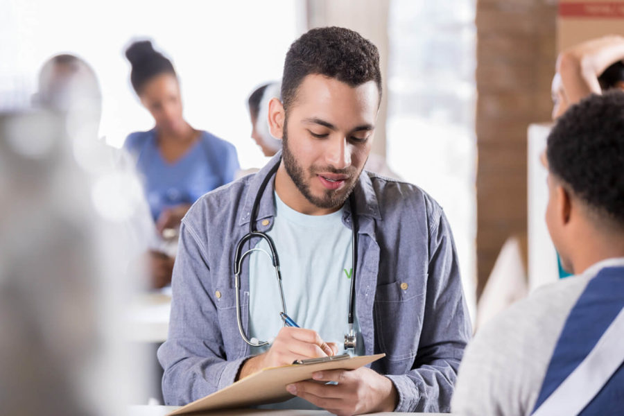 Young male doctor volunteers in free clinic