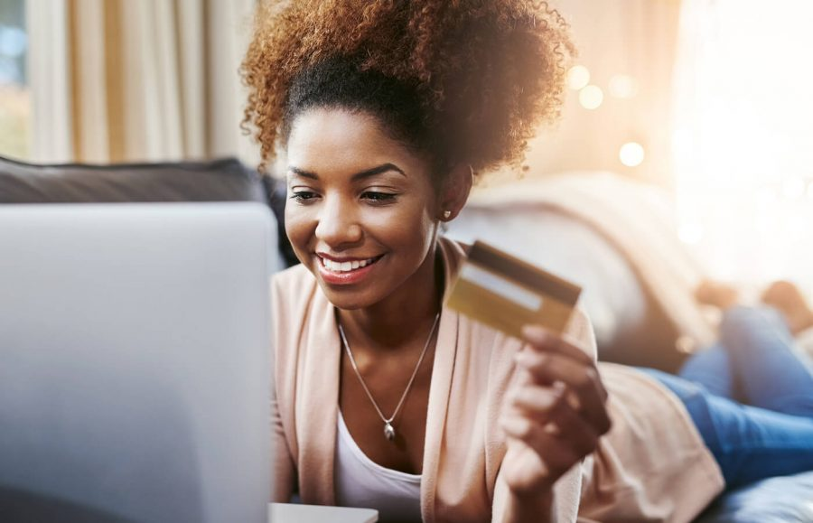 Woman on her laptop shopping with credit card