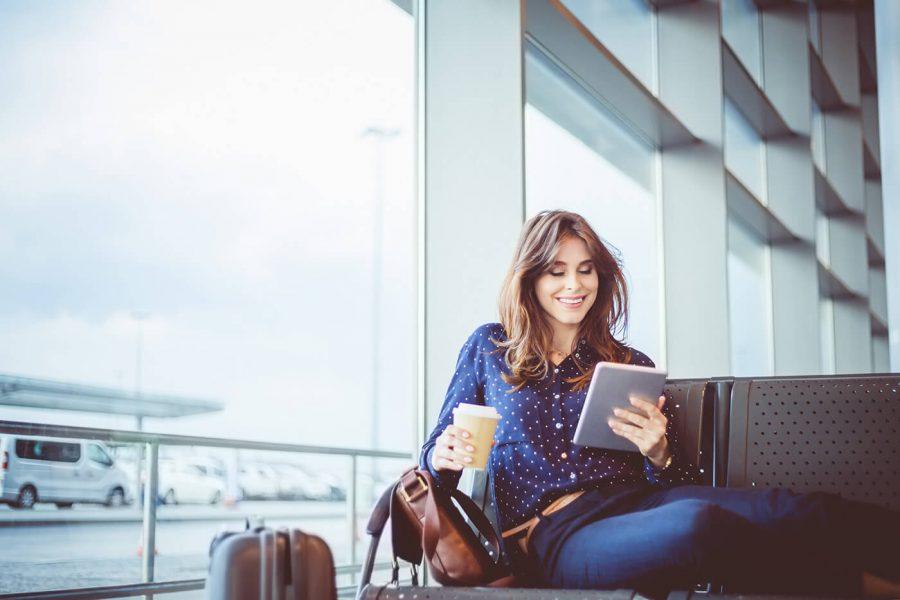 Female passenger waiting her flight at airport lounge
